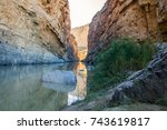 calm rio grande reflects the... | Shutterstock . vector #743619817