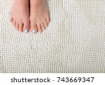 woman feet with a blue pedicure ... | Shutterstock . vector #743669347