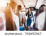a stewardess is posing on the...   Shutterstock . vector #743692567