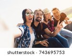 a group of tourists are sitting ... | Shutterstock . vector #743695753