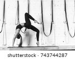 Woman Doing Yoga Exercises In...