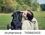 a woman with dog in the park. | Shutterstock . vector #743862433