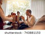 little girl surprising her... | Shutterstock . vector #743881153
