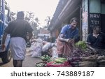 Small photo of Thrissur, Shakthan Vegetable Market, Kerala, India : 2nd October 2017 - Unknown old man arrange and categorize the vegetables in order to attract local business in the morning time..