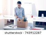 sad brunette leaving work after ... | Shutterstock . vector #743912287