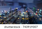 Small photo of Double espouse moving train motion and blurred bokeh light city downtown, abstract background