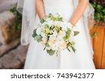 wedding bouquet in bride hands. | Shutterstock . vector #743942377