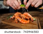 male hands cooking large tasty... | Shutterstock . vector #743946583