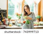 beautiful young woman cooking... | Shutterstock . vector #743999713