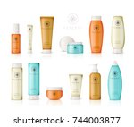 realistic cosmetic bottles with ... | Shutterstock .eps vector #744003877