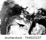 abstract black and white ink... | Shutterstock . vector #744025237