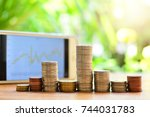 Small photo of coins pile on table set like graph for concept fund investment finance and business