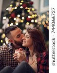 young couple in love kisses at... | Shutterstock . vector #744066727