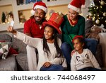 happy family making xmas selfie ... | Shutterstock . vector #744068497