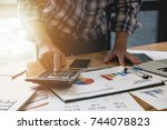 close up of a man accountant... | Shutterstock . vector #744078823