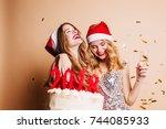 excited blonde girl in santa... | Shutterstock . vector #744085933
