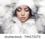 fashion studio portrait of... | Shutterstock . vector #744172273