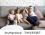 group of four happy cute... | Shutterstock . vector #744193387