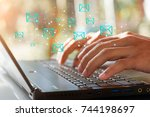 businessman hand using laptop... | Shutterstock . vector #744198697