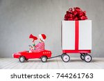 happy child with christmas gift.... | Shutterstock . vector #744261763