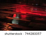 red neon light reflections on... | Shutterstock . vector #744283357