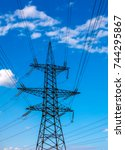high voltage  power lines at... | Shutterstock . vector #744295867