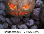 jack o lantern on the ground... | Shutterstock . vector #744296293