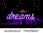 purple neon inscription dreams... | Shutterstock . vector #744298687