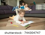 little boy playing on floor... | Shutterstock . vector #744304747
