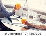 two businesspeople meeting for... | Shutterstock . vector #744307303
