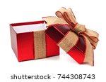 opened red gift box wrapped... | Shutterstock . vector #744308743