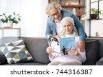 joyful mature husband and wife... | Shutterstock . vector #744316387