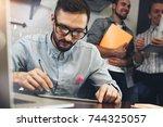 bearded glasses manager... | Shutterstock . vector #744325057