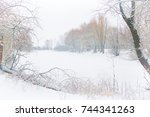 winter lake with snow covered...   Shutterstock . vector #744341263