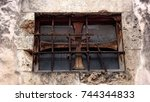 old rusty window with iron... | Shutterstock . vector #744344833
