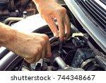car mechanic providing car... | Shutterstock . vector #744348667