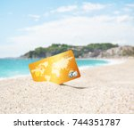 credit card on tropical beach   Shutterstock . vector #744351787