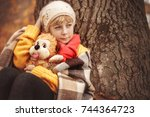 little girl in  yellow sweater ... | Shutterstock . vector #744364723