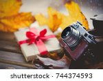 vintage photo camera and gift... | Shutterstock . vector #744374593