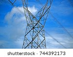transmission line tower on blue ... | Shutterstock . vector #744392173