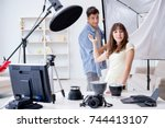 young photographer working in... | Shutterstock . vector #744413107