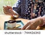 elder senior eating blueberry... | Shutterstock . vector #744426343