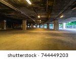 empty underground garage | Shutterstock . vector #744449203