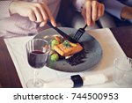 couple eating romantic dinner... | Shutterstock . vector #744500953