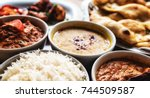 table filled with freshly made... | Shutterstock . vector #744509587