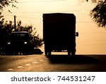 car rides on the road at sunset ... | Shutterstock . vector #744531247