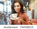woman drinking coffee in a cafe | Shutterstock . vector #744538213