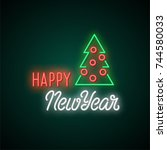 happy new year neon text.... | Shutterstock .eps vector #744580033