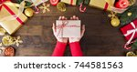 woman in a red sweater giving a ... | Shutterstock . vector #744581563