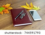 closed leather brown notepad ... | Shutterstock . vector #744591793
